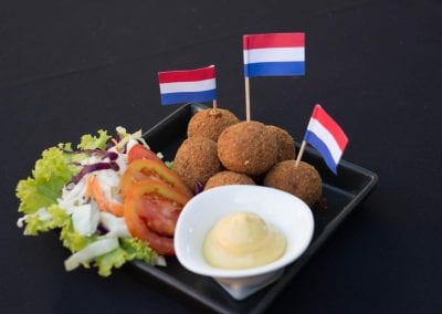 Portion of 6 Dutch Bitterballen served with Dijon Mustard