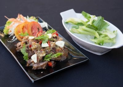 Grilled pork / beef salad with sweet sauce with lime, garlic / chili sauce
