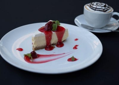 NEW YORK CHEESECAKE, specially homemade Cheese Cake with your Choice of Strawberry, Blueberry or Cherry Sauce